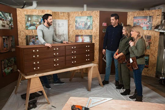 """Property Brothers"" hosts Drew Scott, left, and his brother, Jonathan Scott, show off a set of drawers that will be be part of 'A Very Brady Renovation' to 'The Brady Bunch' stars Maureen McCormick and Susan Olsen."