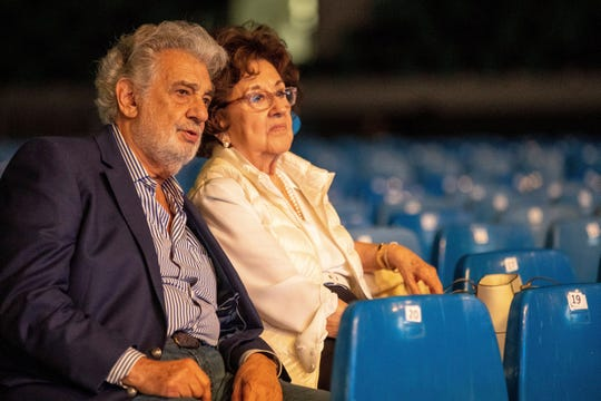 In this Tuesday, Aug. 27, 2019 file photo, Placido Domingo and his wife, Marta, attend a rehearsal for the opening gala of the Gerard of Sagredo Youth Forum and Sports Center in Szeged, Hungary, a day prior to the event.