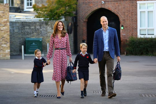 From left to right: Princess Charlotte, Duchess Kate, Prince George and Prince William arrive for Charlotte's first day of school.