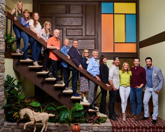 HGTV hosts and cast members from 'The Brady Bunch' pose on a carbon copy of the sitcom's iconic staircase, part of a home transformation that will be shown on HGTV's 'A Very Brady Renovation.'