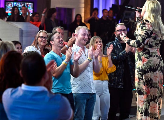 Kelly Clarkson finishes a song in close proximity to audience members on 'The Kelly Clarkson Show.'