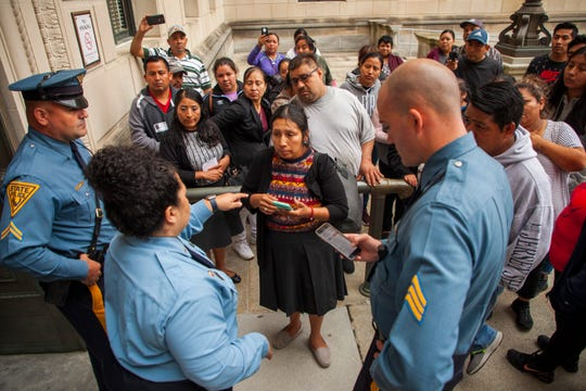 New Jersey State House security guard Rosa Ayala gives directions to the Lakewood parents who drove to Trenton hoping to meet with elected officials to draw their attention to the crisis in their school district.