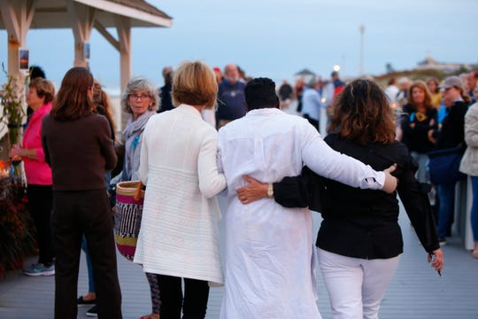 Linda Robison (center) arrives for the candlelight vigil for her 15 year old grandson Josiah Jeremiah Robison, who drowned in Spring Lake over the weekend.Spring Lake,NJ. Thursday, September 5, 2019.Noah K. Murray-Correspondent/Asbury Park Press