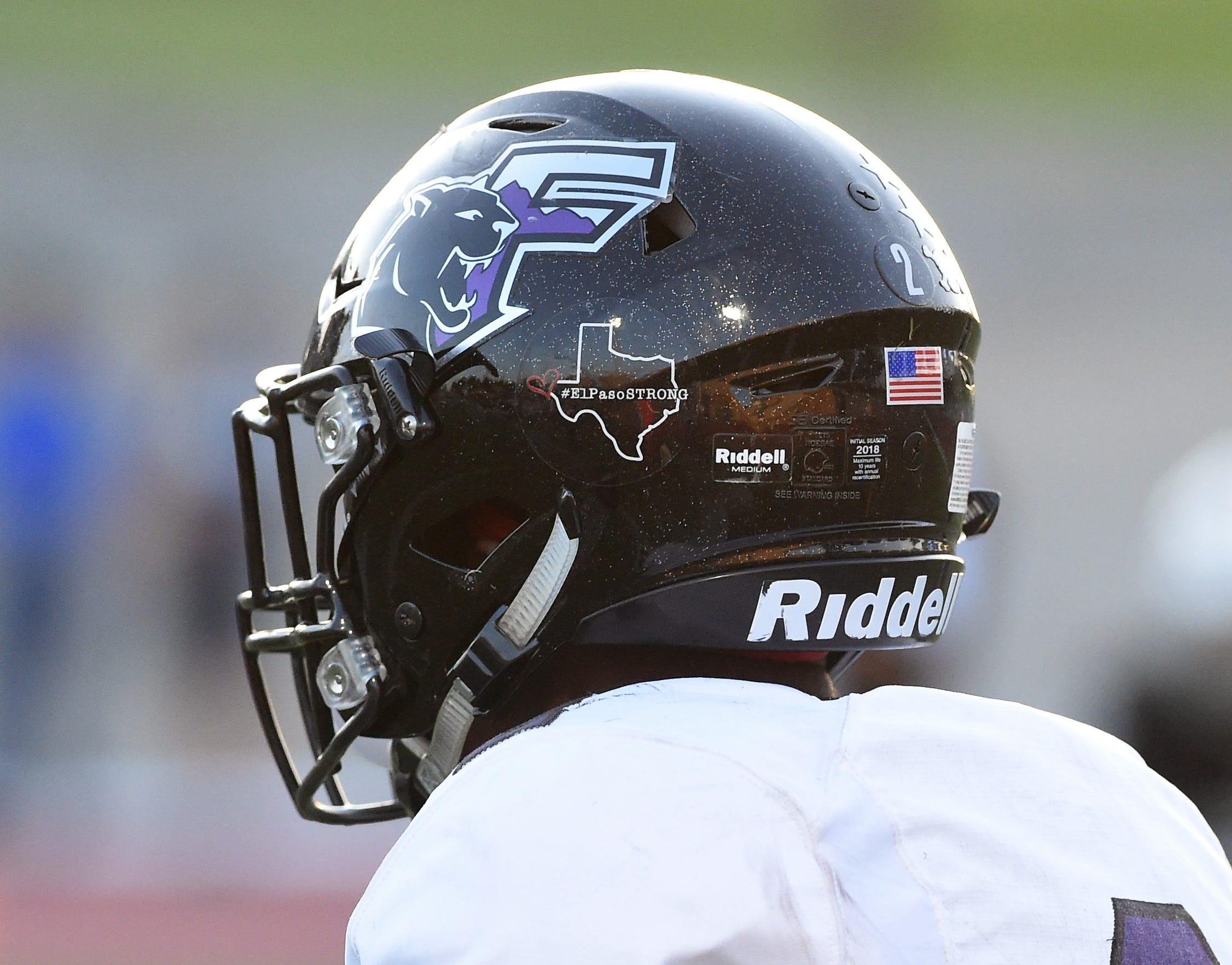 The El Paso Franklin helmets have an #ElPasoStrong sticker on them this season following the shooting in El Paso on Aug. 3. The Cougars played Odessa Permian at Ratliff Stadium.
