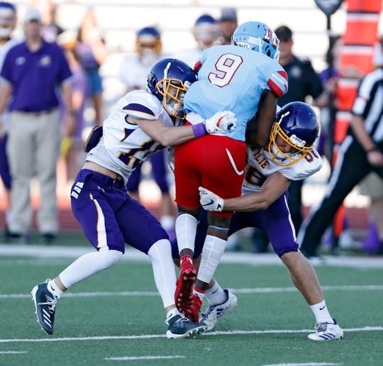 Lubbock Monterey's Donavaughn Hill (9) is tackled with the ball during the game against Wylie, Thursday, Sept. 5, 2019, at Lowrey Field in Lubbock.