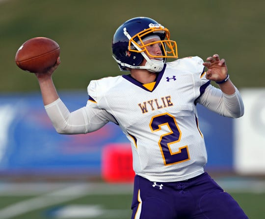 Wylie's Balin Valentine (2) passes the ball during the game against Lubbock Monterey on Thursday, Sept. 5, 2019, at Lowrey Field in Lubbock.