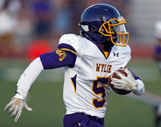 Wylie's Trey Dutton (5) runs with the ball during the game against Lubbock Monterey on Thursday, Sept. 5, 2019, at Lowrey Field in Lubbock.