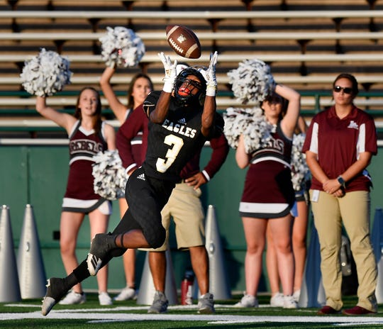 Eagles wide receiver Tre Phillips catches a pass during Abilene High's game against the Midland Lee Rebels Thursday at Shotwell Stadium Sept. 5, 2019. Final score was 35-21, Midland Lee.