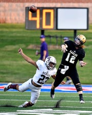 Abilene High quarterback Eric Abbe passes right before getting tackled by Rebels defensive back Damian Garcia during the Eagles' game against Midland Lee last Thursday at Shotwell Stadium. Lee won 35-21. It was Abbe's second game since suffering a season-ending injury in Week 1 last season.