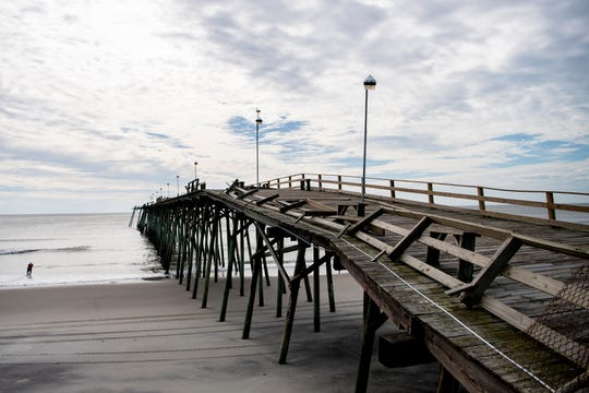 The railing on the Kure Beach Pier in Kure Beach, North Carolina was damaged following Hurricane Dorian on Sept. 6, 2019.