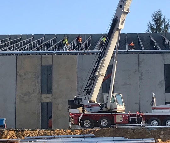 "Last week, workers swarmed over The Riveter, a new adventure center in Mills River slated to open in February, 2020. It will feature climbing walls, bike tracks, a yoga studio, a ""libation station"" and more."