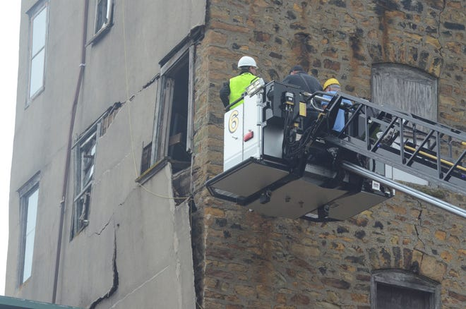 Inspectors used a fire truck aerial to reach the top levels of the building.