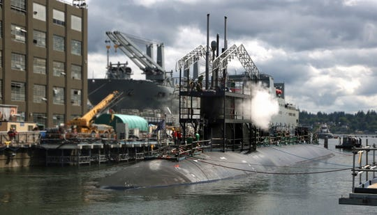 The USS Connecticut receives maintenance work at the Puget Sound Naval Shipyard.