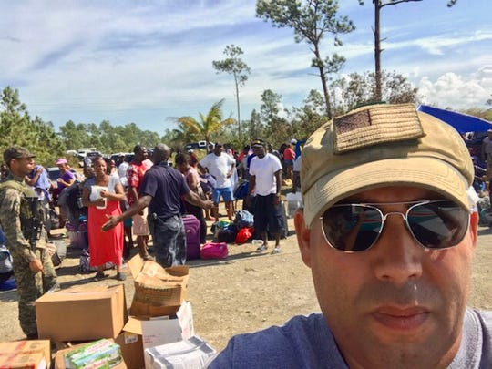 Miguel Estremera, who co-pilots Brevard Bahamas relief flights aboard a  Florida Institute of Technology plane, takes a selfie at the Sandy Point on Great Abaco Island.