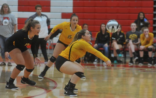 Colonel Crawford's Olivia Pasqualini digs out a Bucyrus serve.