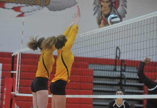 Colonel Crawford's Rylee Ritzhaupt and Alivia Studer attempt to block a Bucyrus hit at the net.