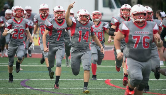 Members of the Cherry Hill East football team run onto the field prior to the season opening game between Deptford and Cherry Hill East, played at Cherry Hill West High School on Thursday, September 5, 2019.  Deptford defeated Cherry Hill East, 44-6.