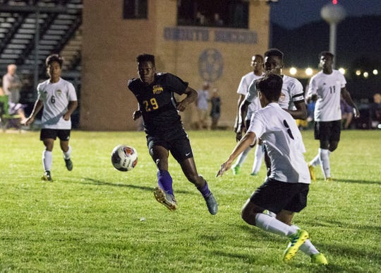 Unioto's Vijay Wangui scores Unioto's first goal late in the first half of their match with Beechcroft at Unioto High School on September 5, 2019. The Shermans went one to win 2-1.