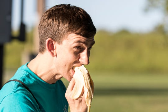 "Michael Barga eats a banana before he participates in the ""Connecting for Life"" 5k on Thursday, September 5, 2019. The event is held annually to help raise funds for suicide awareness."