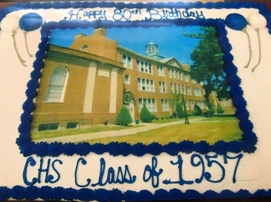 The Chillicothe High School Class of 1957 recently held a reunion. It included an 80th birthday cake featuring the Arch Street building.