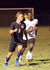 Unioto's Ethan Kerns dribbles the ball during a 2-1 win over Beechcroft at Unioto High School in Chillicothe, Ohio on Thursday Sept. 5, 2019.