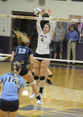 Unioto volleyball's Cree Stulley attempts to block a ball during a 3-2 win over Adena on Thursday Sept. 5, 2019.