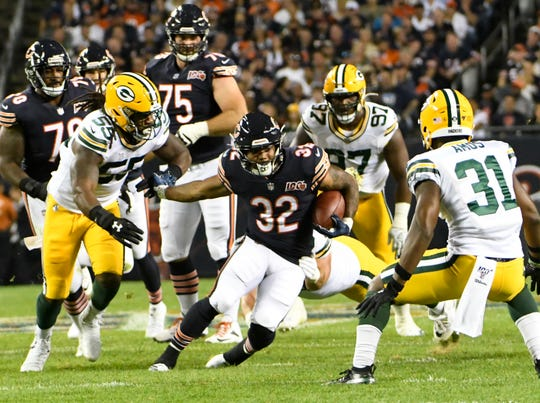 Chicago Bears' David Montgomery runs during the first half of an NFL football game against the Green Bay Packers Thursday, Sept. 5, 2019, in Chicago.