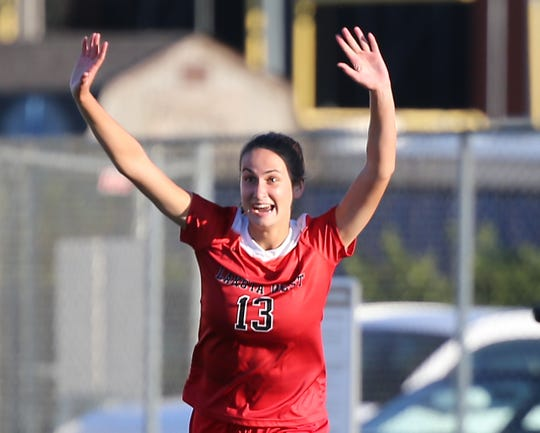 Lakota West player Kailyn Dudukovich  (13) celebrates after scoring one of her four goals during their 6-0 soccer win over Lakota East Thursday, Sept. 5, 2019.