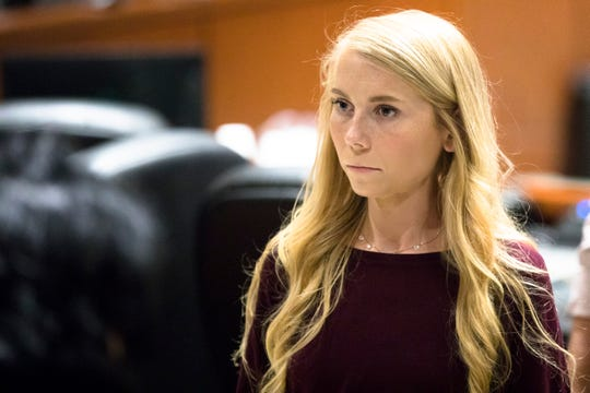 "Brooke ""Skylar"" Richardson steps out of the courtroom during a recess of proceedings, Friday, Sept. 6, 2019, in Warren County Judge Donald Oda's II courtroom at Warren County Common Pleas Court in Lebanon, Ohio. Richardson is charged with aggravated murder, involuntary manslaughter, gross abuse of a corpse, tampering with evidence and child endangerment in the death of her newborn infant."