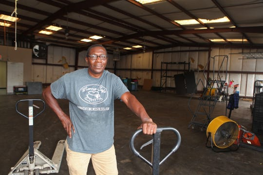 Manna Cafe warehouse manager Bernard Townsend moves the final boxes out of the Franklin Street location of Manna Cafe on Aug. 27, 2019.