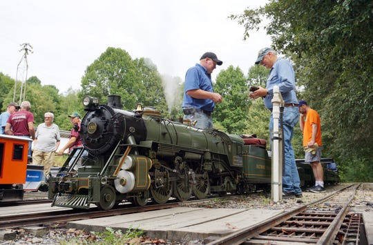 A live steam model of a Baltimore and Ohio steam locomotive simmers under the watchful eye of its crew at the Mill Creek Central Railroad in Coshocton recentlyl.