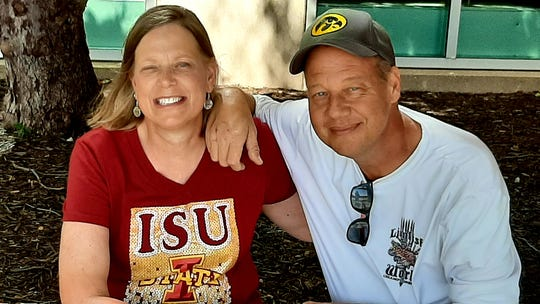 Ann Sampson, an Iowa State University alumna, donated a kidney to her brother, Joe Sampson, a University of Iowa Hawkeyes fan, on Monday before this year's football game.
