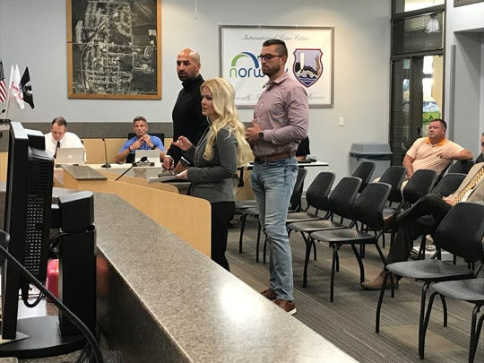 (From left) Developer Ryan Huegerich, Norwalk Economic Development Director Hollie Zajiceck and developer Brandon Vonnahme present their plan for a Sleep Inn Hotel to city council Thursday.