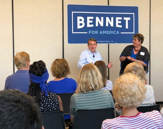 Sen. Michael Bennet of Colorado speaks with a crowd gathered for a town hall moderated by the 2017 Iowa Teacher of the Year, Shelly Vroegh, on Sept. 6, 2019, at Central Campus in downtown Des Moines during one of his campaign stops.