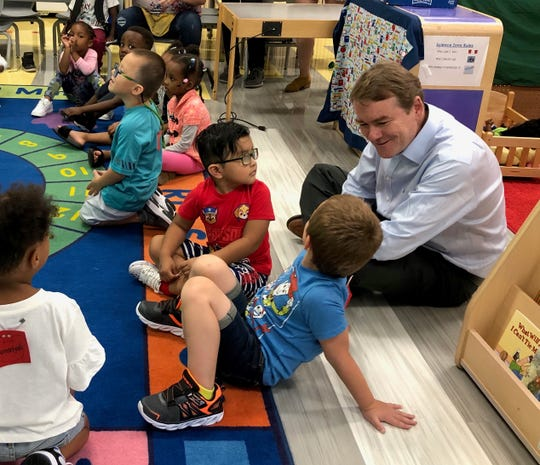 Sen. Michael Bennet visits with preschoolers on Sept. 5, 2019, at Jesse Franklin Taylor Education Center during a campaign stop.