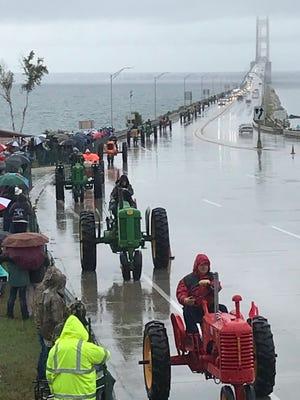 Some 1500 antique tractors cross the Mackinac Bridge on Sept. 6, 2019.