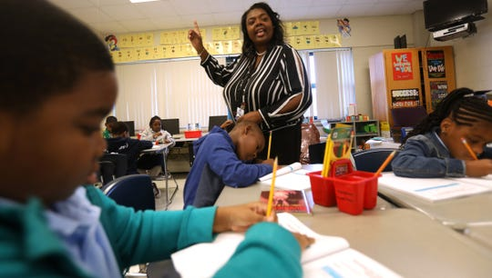 Third grade teacher Michelle Ballard makes a point in her lesson to her students during class at the Charles Wright Academy of Arts and Science in Detroit, Michigan on Friday, Sept. 6, 2019.