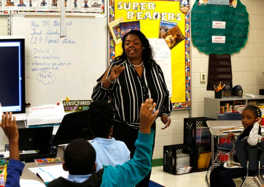 Third grade teacher Michelle Ballard calls on a student to answer one of her questions during class at the Charles Wright Academy of Arts and Science in Detroit, Michigan on Friday, Sept. 6, 2019.