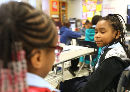 (L to R) Third graders Ahzaria Carr and Alisha Hodges talk about inferences that they were learning about during a lesson by their teacher Michelle Ballard during class at the Charles Wright Academy of Arts and Science in Detroit, Michigan on Friday, Sept. 6, 2019.