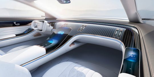 The interior of the EQ concept luxury sedan Mercedes will show at the 2019 Frankfurt auto show is airy and elegant.