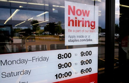 """In this Aug. 15, 2019, photo a """"Now hiring"""" sign is displayed on the front door of a Staples store in Manchester, N.H. On Thursday, Sept. 5, payroll processor ADP reports how many jobs private employers added in August."""
