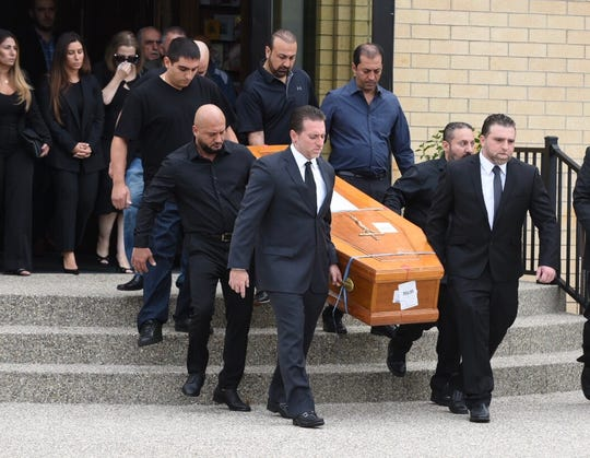 Pallbearers carry the casket of Jimmy Aldaoud, a refugee who died after he was deported to Iraq, after a memorial service Friday at the Mother of God Chaldean Catholic Church in Southfield.
