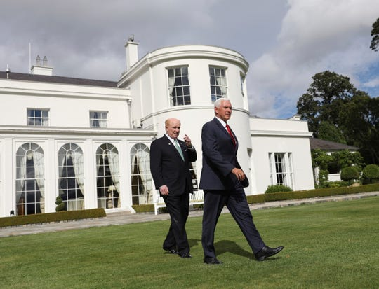 U.S. Vice President Mike Pence, right, and U.S. Ambassador to Ireland Edward Crawford at the ambassador's residence in Phoenix park, Dublin, Ireland, Tuesday, Sept. 3, 2019.