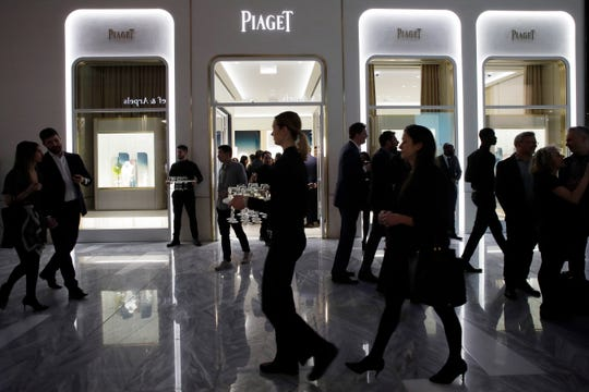 People attend the opening of a Piaget store during the opening night of The Shops & Restaurants at Hudson Yards in New York.