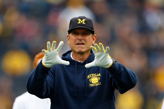 A member of Jim Harbaugh's football staff has joined Army.