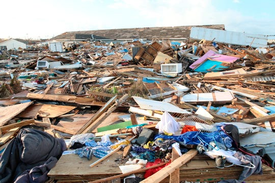 The extensive damage and destruction in the aftermath of Hurricane Dorian is seen in The Mudd, Great Abaco, Bahamas, Thursday, Sept. 5, 2019. The Mudd was built by thousands of Haitian migrants over decades. It was razed in a matter of hours by Dorian, which reduced it to piles of splintered plywood and two-by-fours 4 and 5 feet deep, spread over an area equal to several football fields.