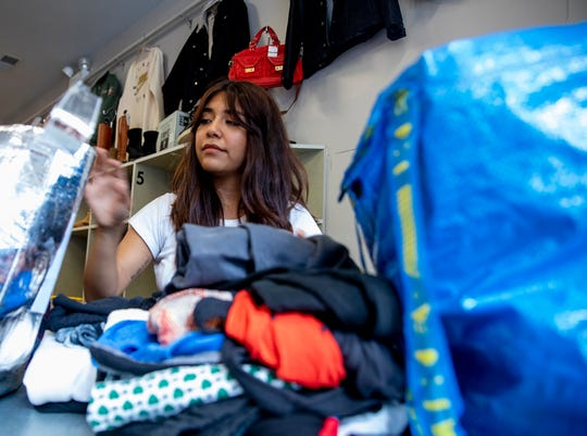 Associate Manager of secondhand apparel store Crossroads Trading, Wendy Garfias, 22, buys and trades clothing from costumers in Chicago's Wicker Park neighborhood, Tuesday, August 27, 2019. (Camille Fine/Chicago Tribune/TNS)