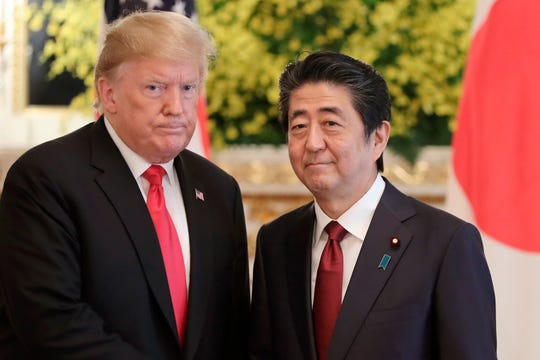 FILE - In this May 27, 2019, file photo, U.S. President Donald Trump, left, and Japanese Prime Minister Shinzo Abe pose for a photo prior to their meeting at Akasaka Palace, Japanese state guest house, in Tokyo. Japan's defense spending is expected to set a new record next year as the country strengthens its military alliance with the U.S. and buys expensive American weapons amid threats from China and North Korea.