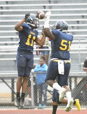 Denby's Marques Bridges and Javier Johnson celebrate Johnson's touchdown run in the third quarter. Detroit Denby defeated Ecorse 39-0 Friday.