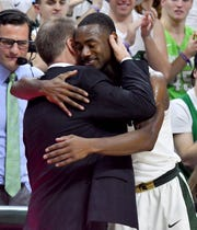 """Tum Tum"" Nairn Jr. hugs Tom Izzo as he leaves the home floor for the last time as Michigan State beats Illinois on Feb. 20, 2018."